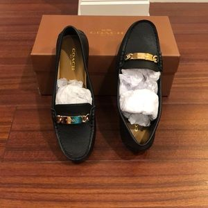 Brand new Genuine Leather Coach slip ons